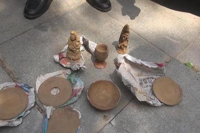 工地挖出的古董只卖100多元 郑州街头出现这种骗局