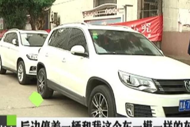 郑州男子出门碰见俩人换车胎 居然是自己车胎被换掉
