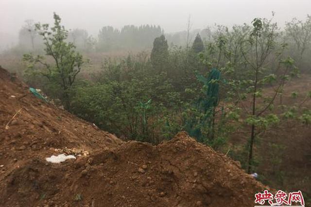 新密村民耕地被倒建筑垃圾 公司:正申请变更土地性质