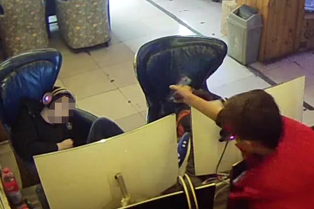 信阳一男子网吧盗窃手机 3次起身扫描失主面部解锁