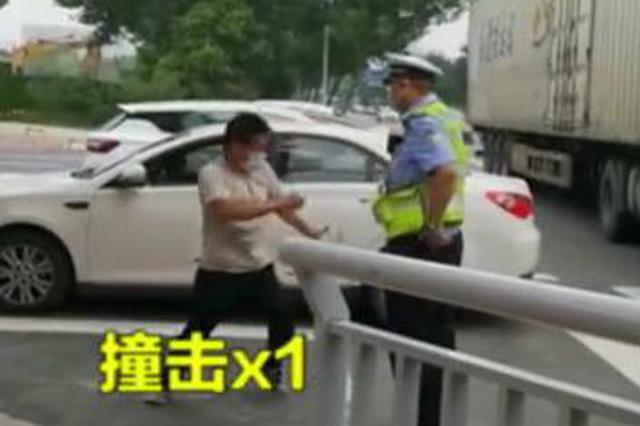 限行被拦 郑州一司机助跑撞击民警4次:我死到你面前