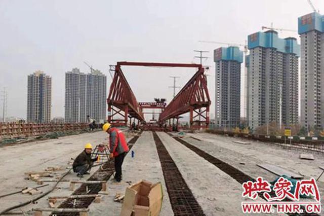 漯河107国道沙河桥桥梁主体正式合龙 通车进入倒计时