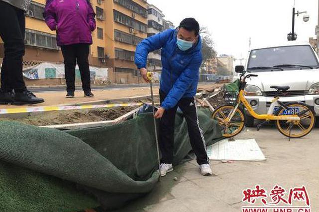 郑州一小区被新修道路堵住 路面高出小区地面近1米