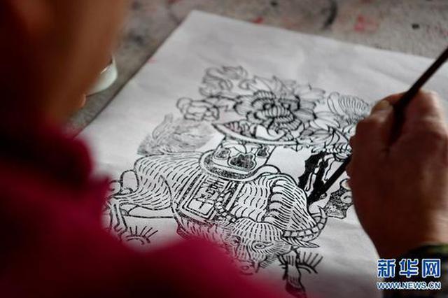开封朱仙镇:木版雕刻印年画 浓浓年味迎新春(图)