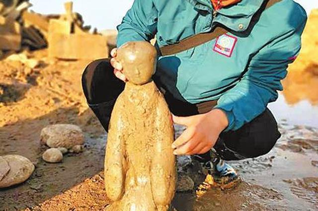 洛阳黄河河道首次发现完整西汉陶仕女俑
