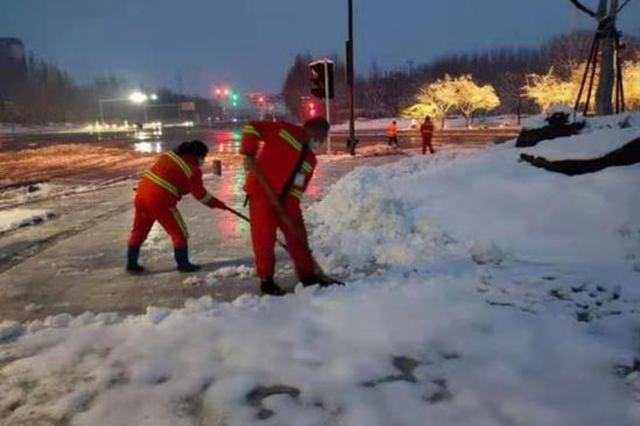 顶风冒雪忙在街头 昨夜 他们是惠济区最可爱的人