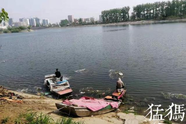 """周口河段藏超万米""""绝户网"""" 民间河长制止遭报复巡逻"""