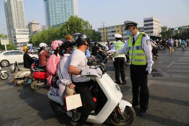 郑州10天录入非机动车交通违法19214起 戴头盔情况有好转