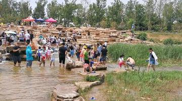 郑州贾鲁河的网红瀑布到底怎么样?