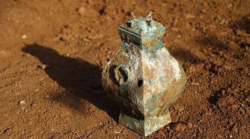 洛阳发掘6汉墓 又见铜壶液体