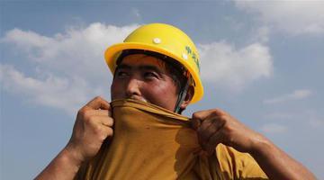 新密:国道改建工程施工忙