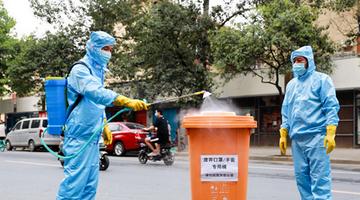 直击现场:疫情之下废弃口罩如何处理?