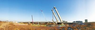 形似箜篌,位于中牟县的这座跨贾鲁河大桥主体已经完工。