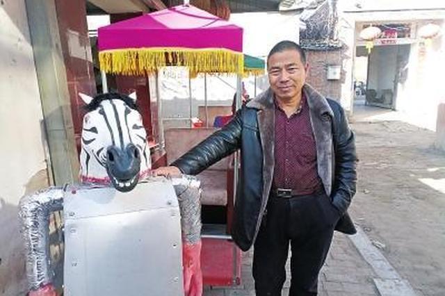 濮阳农民造出会摆臂拉车机器人 充满电可连续走5小时