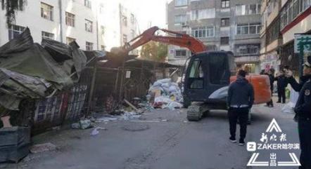 阻碍消防通道 黑龙江中医药大学校内8处违章建筑被拆除
