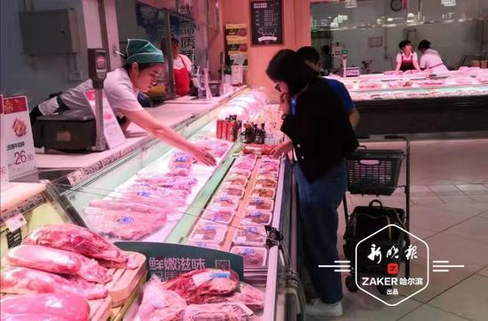 商家提早准备 猪肉打起折扣小长假购销两旺节味浓