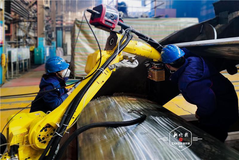 哈电电机首次实现发电设备大型关键部件机器人焊接