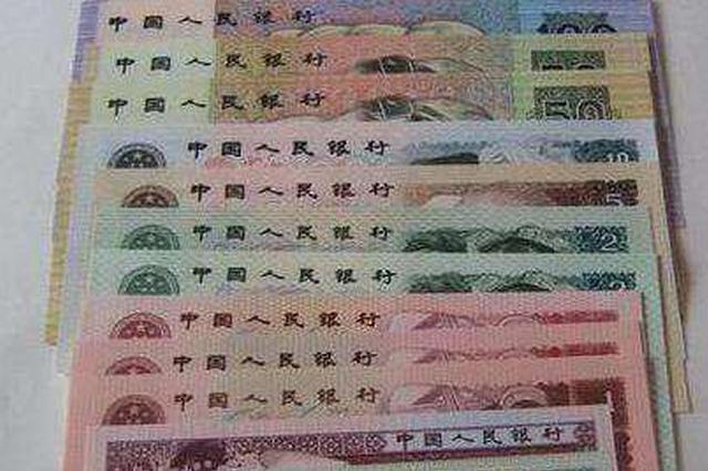 哈市收藏市场第四套人民币一套卖两万多 以后还会涨