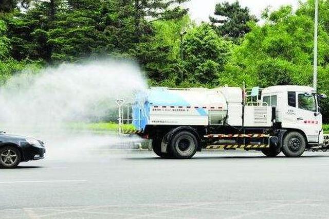千台洒水车洒扫除尘 哈市街路清扫延长保洁时间