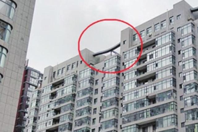 私建盯上高层楼顶 业主认错将恢复原样(图)
