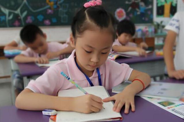 """开辟""""家校直通车"""" 哈尔滨多举措促中小学教育均衡发展"""