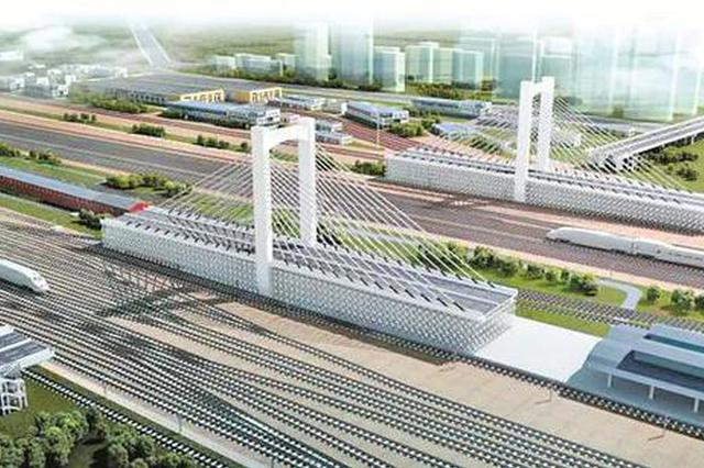 跨哈南站48条既有线 哈尔滨市首座转体桥主塔封顶