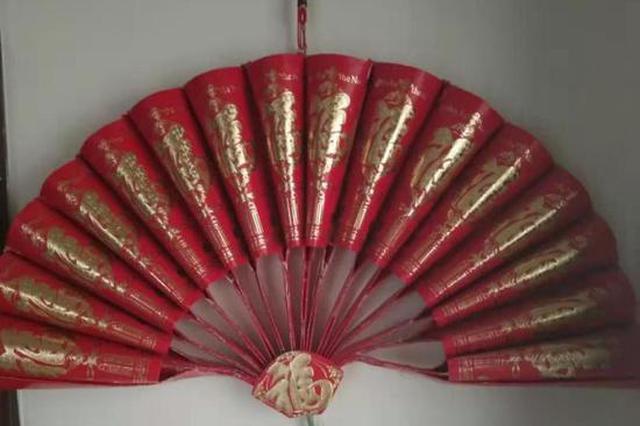 """过年带娃学折纸 跟民间艺人学做""""红包扇子"""""""