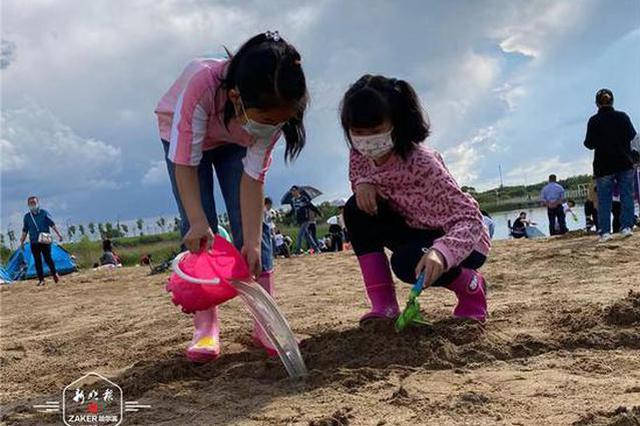 晴(qing)雨無妨(fang),快(kuai)樂過六(liu)一!大劇院沙灘區和兒童公園充(chong)滿(man)歡(huan)歌笑語