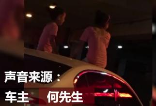 """长沙女子闹市中开车 两女儿竟端坐车顶""""兜风"""""""