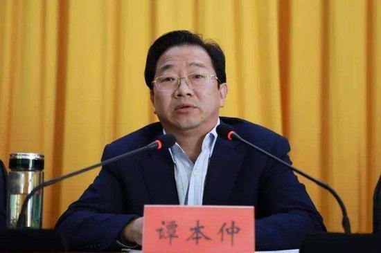湖南检察机关依法对谭本仲涉嫌受贿案提起公诉