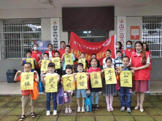 """归义镇高塘社区""""关爱未成年,践行社会主义核心价值观""""志愿服务活动"""