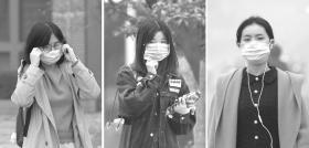 12月2日,长沙靳江路附近,因为雾霾严重,一些市民戴起了口罩。 组图/记者谢长贵
