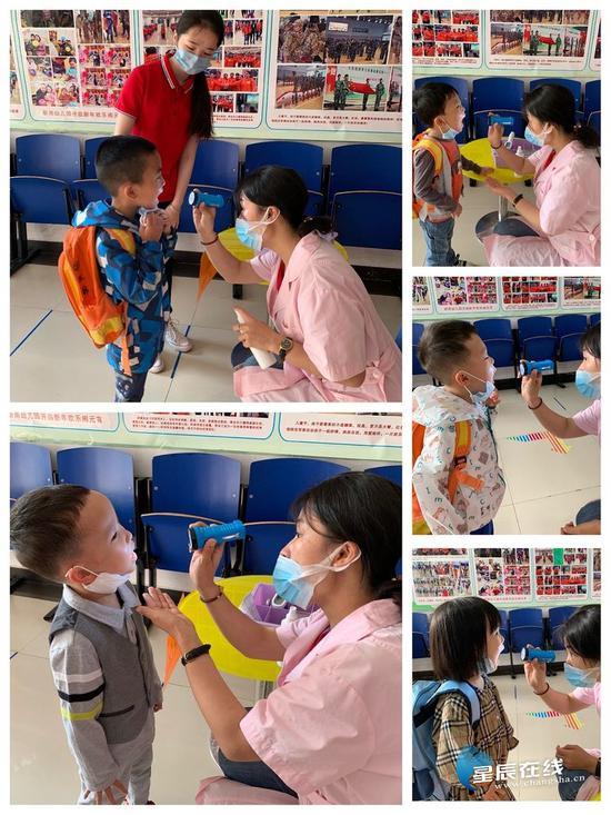 晨检区卫生老师为幼儿检查口腔、指甲等,孩子们都非常配合。