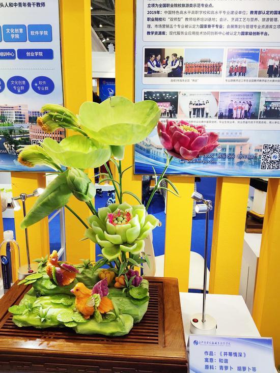 """长沙一对师徒把大萝卜雕成""""真花"""" 在世界级展会引大家打cal"""