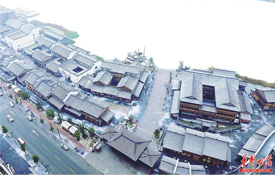 """纷飞的雪花使整个常德河街""""银装素裹""""。 刘颂 摄"""