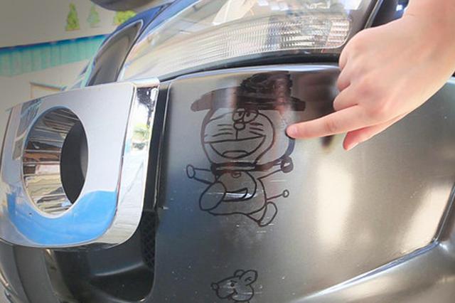 常德一小车被刮擦遭涂鸦 网友点赞:画得挺好