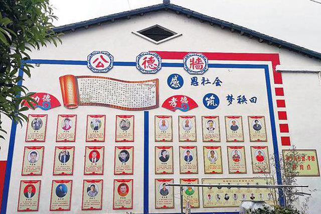 26名博士176名硕士,湖南5000多人的村里有面博士墙
