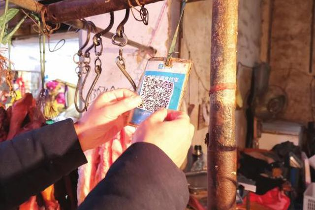 长沙一市场百余商户收款码被盗贴 警方介入调查