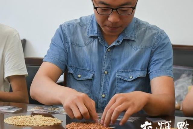 """扬州大学录取通知书中藏种子 送新生特殊""""见面礼"""""""
