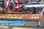 奇葩小偷商铺偷香烟 故作镇定扮店员