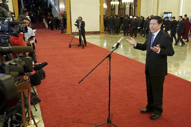 国家税务总局局长王军:个税改革将使工薪阶层百分之百减税