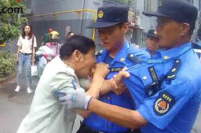 无锡一对父子暴力抗法 用嘴咬、用头撞击城管被拘留