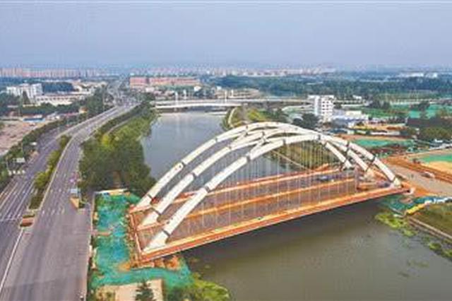 南京外秦淮上架起江苏省内最大系杆拱桥