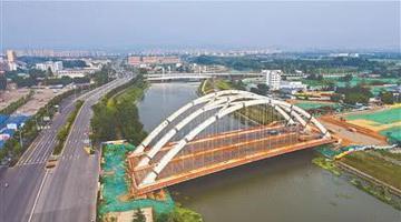 南京外秦淮架起江苏最大系杆拱桥