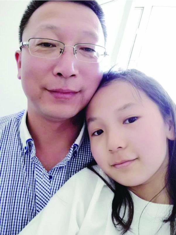 孙宏志和女儿的合影。(图片由孙宏志本人提供)