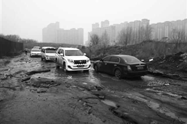 长春市绿园区锦绣溪城小区外路面低洼积水盼维修