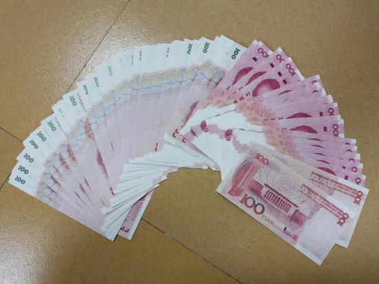 8000张假币流入赣州!多名作案男女现场被警方带走