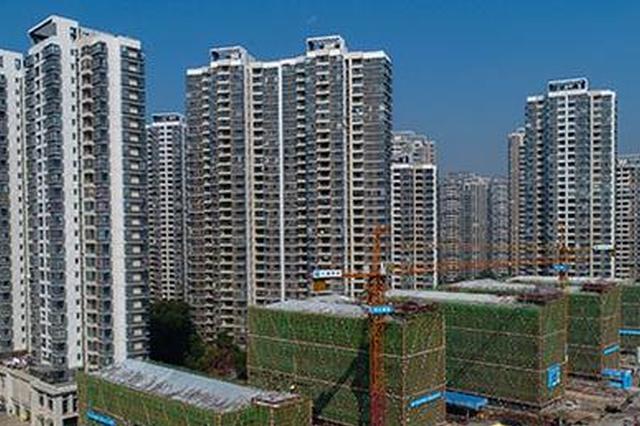 明升体育华南城学校教学楼主体封顶 明年3月底建成