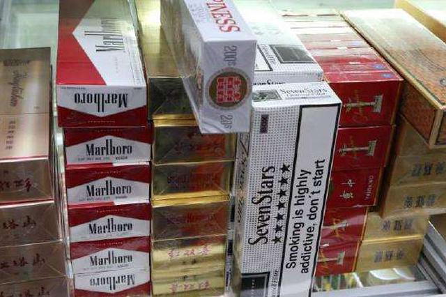 团伙将香烟藏在客车暗格走私入境 涉案6.38亿元