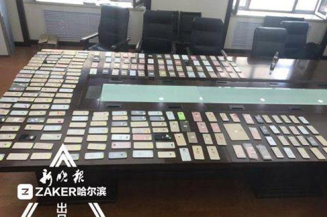 """1000余部被盗手机铺满会议桌 15人组团""""盗改销"""""""